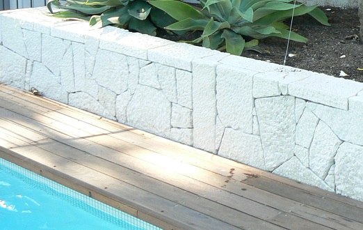 poolside timber and stone features