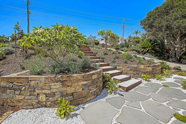 Check out this amazing natural stairway through a landscaped garden