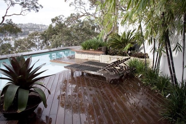 outdoor landscaped pool, deck and garden area