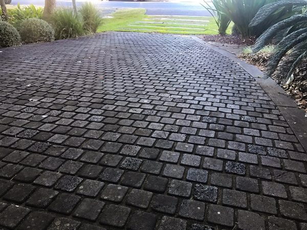 Square stone patterned driveway kept in immaculate condition.