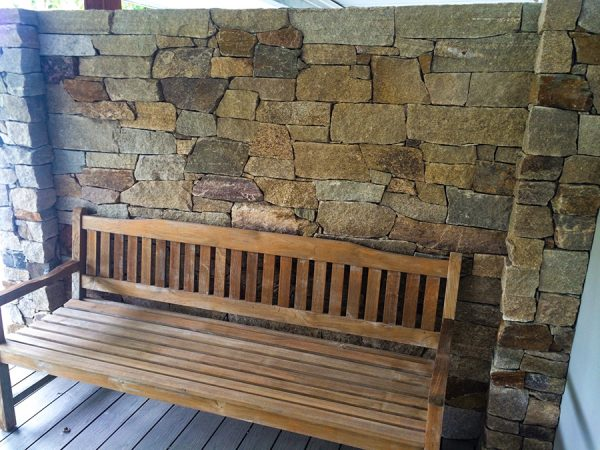 Outdoor seated area designs including this stone cladding wall, on the Central Coast NSW.