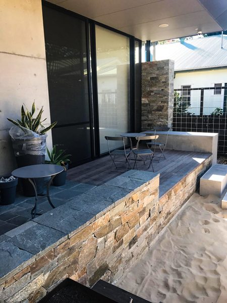 Stone Cladding Retaining Wall for a unique Outdoor Area. An example of our landscape design on the Central Coast.