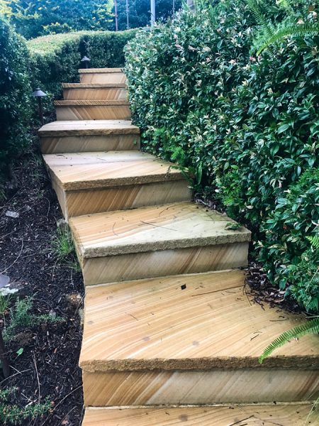 This beautiful example of stonework paving by Central Coast landscapers utilises natural sandstone for a coastal stairway that lends itself to formality with hedging, or a relaxed garden with local species planting